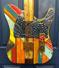 Electric in sound and in color, this Telecaster wall sculpture is sure to add a spark to any wall. This bright beauty is handcrafted from reclaimed wood and found objects and is shown in the head-turning under the Sun colorway. Just remember…no stairway Guitar Wall Art, Music Wall Art, Wood Pallet Art, Reclaimed Wood Art, Pallet Furniture, Pyrography Patterns, Metal Yard Art, Fender Telecaster, Bts Drawings