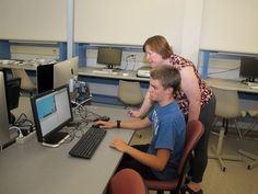 Meri Winchester, digital media instructor, helps a student programming with Raspberry Pi for Minecraft during the MCC Tech Camp.