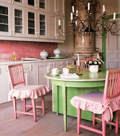 Pretty pink kitchen with elegant chandy