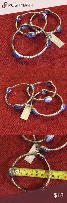 """CHICO'S Bangle Set NWT 3 piece bangle set from Chico's.  Silvertone with blue glass.  Inside of bangle measures 2 3/4"""".  New with tags! Chico's Jewelry Bracelets"""