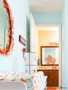 Teal and tangerine beachy nursery.  Not a big fan of orange, but love the combo here.