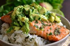 Beautiful honey, lime, and cilantro flavors come together is this tasty salmon rice bowl. Cilantro lime rice with honey, lime salmon and fresh avocado. Avocado Hummus, Salmon With Avocado Salsa, Salmon And Rice, Avocado Rice, Fresh Avocado, Healthy Meals For Kids, Healthy Chicken Recipes, Easy Healthy Recipes, Seafood Recipes