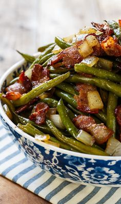 Slow Cooker Barbecued Green Beans are sweet and tangy with lots of smoky bbq flavor. Made from canned beans, they are a cinch to make and are a great side dish for potlucks and family meals. They are kind of like the flavor of baked beans, only with green beans. What's not to love about that?