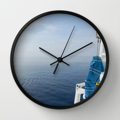 """""""Blue And White Ship's Delight""""  Available in natural wood, black or white frames, $30.00 - our 10"""" diameter unique Wall Clocks feature a high-impact plexiglass crystal face and a backside hook for easy hanging. Choose black or white hands to match your wall clock frame and art design choice. Clock sits 1.75"""" deep and requires 1 AA battery (not included). #clock #wall #sea #homedecor #rigging #blue #ocean"""