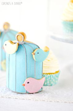 Daily Cupcakes: Cupcakes with vanilla mascarpone and macadamia cookie hidden behind a cage.
