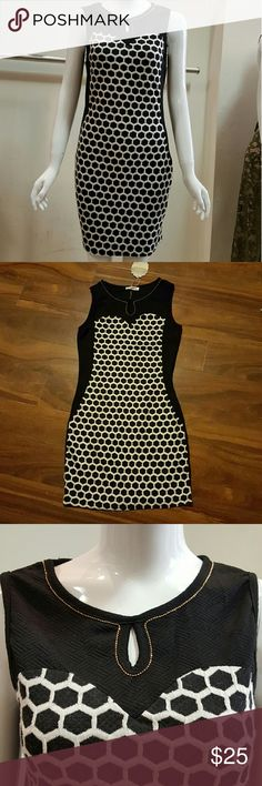 """Dress strech print/solid Strecht Liverpool and jacquard dress black and white print front solid black back  with bead trim around collar. 32"""" lenght Kesley Dresses Mini"""
