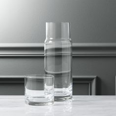 Free Shipping. Shop cora carafe. Two-piece handblown glass cylinder stacks its own cup. Makes a cool wine carafe, too. To learn how certain items like this one can help make house guests feel welcome, check out .