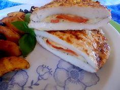 Nadziewany cytrynowy filet z kurczaka z duszonymi jabłkami i żurawiną.