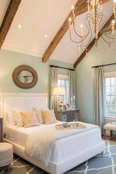 Neutral colors give a soothing feel to this master bedroom.