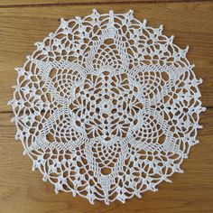 In a vintage style, this lovely handmade crochet lace doily will harmonize perfectly to your home and ideally find its place in table centerpiece or on a small piece of furniture... Its diameter is about 22 cm (8.5 inches). Made of 100% cotton yarn ecru (1 hook). This placemat is made