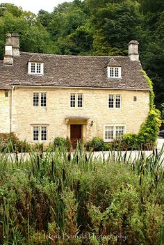 House at Castle Combe, UK. Typical honey-colored stone of the Cotswolds.