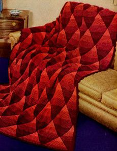 The Red Ombre Pyramid Afghan has a great crochet diamond pattern that gives a 70s vibe.   AllFreeCrochetAfghanPatterns.com