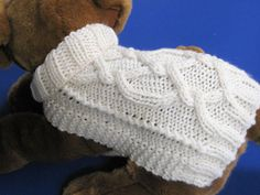 Great for beginner cable knitters. Easy to knit doggie sweater from the Celtic Doggie Designs collection. Simple contruction, easy fit.