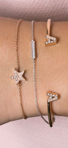 Create the perfect arm candy with our diamond initial cuff paired with sweet and simple station bracelets!
