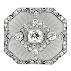 Art Deco Carved Frosted Rock Crystal Diamond Platinum Pendant Brooch | From a unique collection of vintage brooches at http://www.1stdibs.com/jewelry/brooches/brooches/
