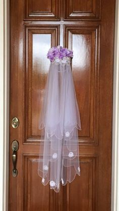 Door decor for my daughter's wedding rehearsal brunch made from my own veil.