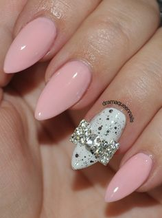 soft pink with an accent black and white nail with bow