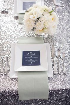 #wedding #events #flowers #centerpiece #silver #sequin #linen