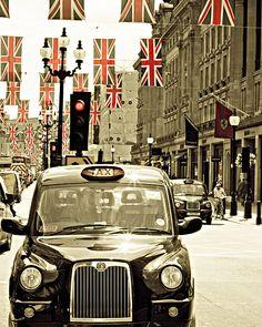 London Photography, fine art photograph of a London cab with union jack flags, Olympics. $30.00, via Etsy.