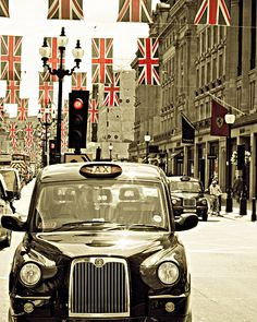London Photography, fine art photograph of a London cab with union jack flags, Olympics. $30.00, via Etsy.