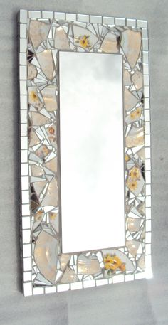 Frameless mirror with ceramic and mosaic tile border.