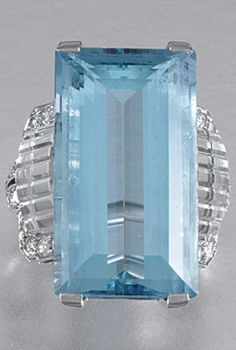 AN ART DECO AQUAMARINE, ROCK CRYSTAL AND DIAMOND RING, BOUCHERON, 1930s. Centring on a step-cut aquamarine to carved rock crystal and diamond shoulders, embellished with circular-cut stones, signed Boucheron, London. #Boucheron #ArtDeco #ring