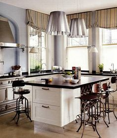 21st c kitchen in a 19th c house with design by Robert Couturier and cabinets by Smallbone. Ultrachic Flos pendants are called Miss K. And oh, mid-century industrial stools.