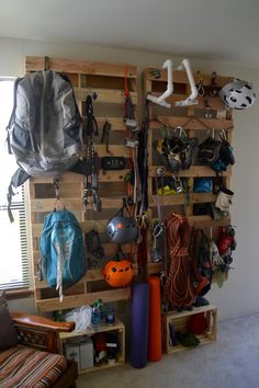 climbing gear wall - great way to repurpose pallets! #gearwall #climbing #palletfurniture
