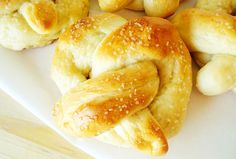 Chewy Soft Pretzels - I've been making these pretzels for years and they certainly don't disappoint. Chewy, soft and slathered in butter and salt, these pretzels are a carb-lover's dream. I make these often for after-school snacks or when the baking bug hits and I need simple ingredients. Seriously, they are absolutely heavenly. via Mel's Kitchen Cafe