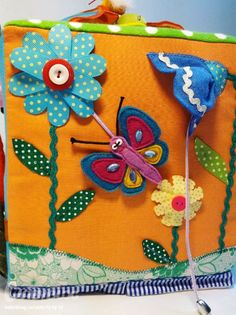 a velcro flower, a sliding butterfly, ribbons to pull, great page for a Quiet book