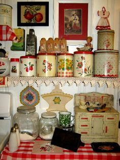 Nice canister collection in this very cute red and white kitchen.