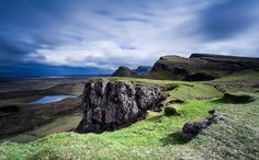 Trotternish Ridge,  Isle of Skye.  The woman standind on an outcrop shows the scale.  I hope to see this next year while I'm on Skye.
