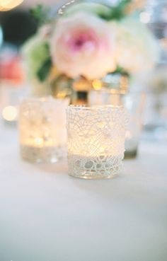 Lace covered jars make pretty tea light holders - A Romantic Wedding with BHLDN Bridesmaid Dresses - Lover.ly