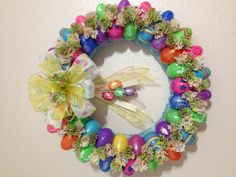 Easter Egg Wreath using plastic eggs and cupcake liner papers. Fun and easy to make!