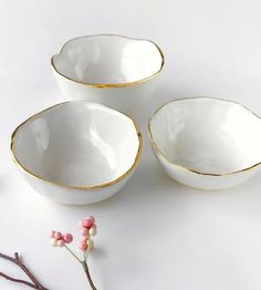 A pretty little spot for small treasures, spices or sauces, this ceramic dish can be used in any room of the house. Each gold tipped dish is formed by hand from white clay into a shallow bowl and glazed glossy white before finishing with a rim of 22k gold. It can hold onto earrings and rings for safekeeping, sit on the kitchen table for use with soy sauce and wasabi or keep your daily allotment of vitamins.
