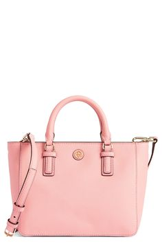 This petite Tory Burch tote in pink includes a slim crossbody strap for chic versatility.