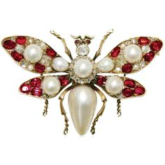 Natural pearl, ruby, and diamond butterfly brooch, set in gold. English, circa 1880.