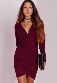 Easily suede? This burgundy bodycon dress is top of our wish lists this season. Play up to your feminine side in this luxe long sleeved number with fierce wrap over feature to the hem and ruched detailing.  Flaunt what you got in this plung...