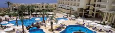 The Hilton Sharks Bay Resort All Inclusive Sharm El Sheikh Egypt is situated just 5km from Sharm airport. Located on the Southern tip of the popular resort of Sharm el Sheikh, the hotel overlooks the clear blue waters with its sanded own private beach.