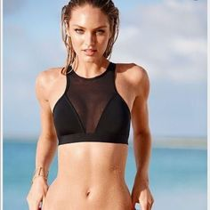 Mesh accented plunge swimsuit top White in color. Size M worn once for a photo shoot Victoria's Secret Swim Bikinis