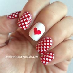 Red and white polka dot nail art with hearr motif on middle finger ☆ pullstrings1:  ❤  Another fabulous mani from my friend...