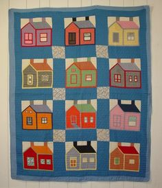 Schoolhouse Quilt on Blue Ground