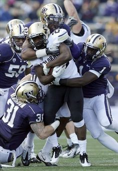 Tony Jones of Colorado......Dragging a couple of Huskies for some hard fought yards
