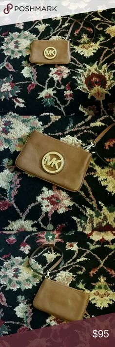 MICHAEL KORS WRISTLET AUTHENTIC MICHAEL KORS WRISTLET Gently Used Near Perfect Condition. Has a few light scratches on the MK Emblem it's Brown with Gold Hardware. The inside looks as if it's new. No Trades NO LOWBALLS I DO TAKE VIDEO AND PICTURES OF ALL ITEMS BEFORE SHIPPING TO PROTECT MYSELF FROM PEOPLE WHO MAKE FALSE CLAIMS TO GET ITEMS FOR FREE. Michael Kors Bags Clutches & Wristlets