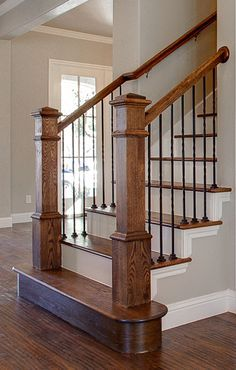 Bannister Custom Homes. Metal Balusters + Stained Banister + Painted Risers + St… Bannister Custom Homes. Staircase Railings, Banisters, Wood Railing, Stairways, Stained Staircase, Indoor Railing, Spiral Staircase, Railing Design, Staircase Design