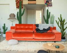 Love the orange couch and the hanging blankets! The cacti are fab too! Orange Couch, Oranges Sofa, Sofas Relax, Living Spaces, Living Room, Apartment Living, Style Deco, Deco Design, Home And Deco