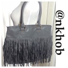 Grey Fringe Purse Grey fringe bag. Zippered top closure. One zipper compartment inside and two smaller ones. Measures 17 X 13 X 6 has  9 inch drop handles .  Man made materials!  NWOT (PB2) Bags Shoulder Bags
