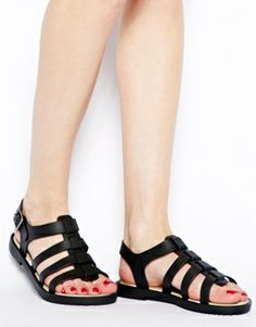 ASOS: Melissa Flox Black Flat Sandals $124.21