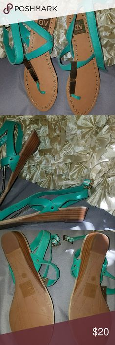 """Summer time sandals! Cute, light weight sandals. Perfect timing for summer! Really pretty teal green with gold accents. They do have about a 1"""" heel to add extra. NWOT! Never been worn. Dolce Vita Shoes Sandals"""