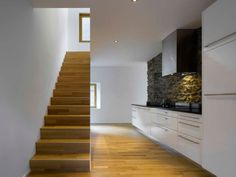 Cool Farmhouse Remodeling with Large Scale of Naturalism: Sleek Wooden Staircase Design And Modern Kitchen Design At Casa With Exposed Stone. Wooden Staircase Design, Wooden Staircases, Wooden Stairs, Stairways, Villa, Stone Barns, Farmhouse Remodel, Modern Kitchen Design, Prefab